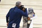 Penn State coach Jim Ferry and Jamari Wheeler hug as they leave the court following the team's win over Nebraska in an NCAA college basketball game against Nebraska at the Big Ten men's tournament Wednesday, March 10, 2021, in Indianapolis. (AP Photo/Darron Cummings)