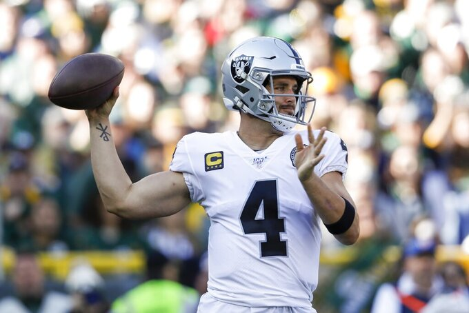 Oakland Raiders' Derek Carr throws during the first half of an NFL football game against the Green Bay Packers Sunday, Oct. 20, 2019, in Green Bay, Wis. (AP Photo/Jeffrey Phelps)
