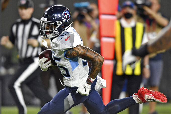 Tennessee Titans cornerback Briean Boddy-Calhoun runs 42-yards for a score after recovering a fumble by the Tampa Bay Buccaneers during the second half of an NFL preseason football game Saturday, Aug. 21, 2021, in Tampa, Fla. (AP Photo/Jason Behnken)