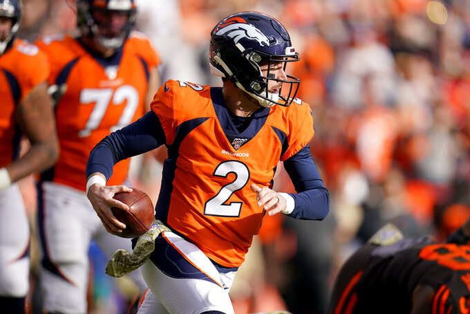 Denver Broncos quarterback Brandon Allen (2) scrambles against the Cleveland Browns during the first half of NFL football game, Sunday, Nov. 3, 2019, in Denver. (AP Photo/Jack Dempsey)