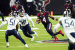 Houston Texans quarterback Deshaun Watson (4) runs for a gain as Tennessee Titans' Harold Landry III (58) and David Long Jr. (51) defend during the second half of an NFL football game Sunday, Jan. 3, 2021, in Houston. (AP Photo/Sam Craft)