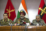 """Indian Army's General Officer Commanding of the Srinagar-based 15 Corps  Lt. Gen. K.J.S. Dhillon, center, speaks as Inspector General of Police Swayam Prakash Pani, left, and Inspector General of Central Reserve Police Force (CRPF) operation Zulfiqar Hassan sit by his side during a joint press conference in Srinagar, Indian controlled Kashmir, Tuesday, Feb. 19, 2019. A top Indian military official in disputed Kashmir on Tuesday accused the Pakistani army and its spy agency for involvement in the last week's deadly car bombing. Dhillon told reporters in Srinagar, the main city of Indian-held Kashmir, that the leadership of Jaish-e-Mohammed militant group was """"eliminated within 100 hours"""" of the Feb. 14 attack, linking the slain militants in Monday's gunbattle to the attack. (AP Photo)"""