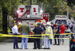 Emergency responders gather where a single-engine plane crashed behind a home on Minchin Drive, Saturday, Sept. 15, 2018, in Woburn, Mass. Officials said Dr. Michael Graver and Jodi Cohen were killed in the crash. The plane had departed from Republic Airport in Farmingdale, N.Y.,  and was en route to Laurence G. Hanscom Field in Bedford, Mass., about four miles from the crash site. (Nicolaus Czarnecki/The Boston Herald via AP)