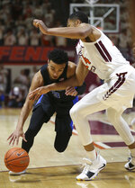 Duke's Tre Jones (3) is defended by Virginia Tech's Kerry Blackshear Jr. (24) during the first half of an NCAA college basketball game in Blacksburg, Va., Tuesday, Feb. 26, 2019. (Matt Gentry/The Roanoke Times via AP)