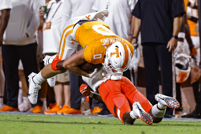 Tennessee wide receiver Grant Frerking (0) is tackled by a Bowling Green defender during the second half of an NCAA college football game Thursday, Sept. 2, 2021, in Knoxville, Tenn. (AP Photo/Wade Payne)