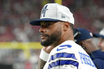Dallas Cowboys quarterback Dak Prescott watches from the sidelines during the first half of an NFL preseason football game against the Arizona Cardinals, Friday, Aug. 13, 2021, in Glendale, Ariz. (AP Photo/Rick Scuteri)