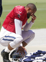 Dallas Cowboys quarterback Dak Prescott (4) takes a moment before walking off the field at the close of NFL football practice in Frisco, Texas, Tuesday, Aug. 24, 2021. (AP Photo/LM Otero)