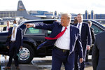 President Donald Trump gestures to supporters as he arrives at Minneapolis Saint Paul International Airport, Wednesday, Sept. 30, 2020, in Minneapolis. (AP Photo/Alex Brandon)