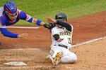 Chicago Cubs catcher Victor Caratini, left, gets the tag on Pittsburgh Pirates' JT Riddle (15) who was attempting to score on a single by Adam Frazier during the fourth inning of a baseball game in Pittsburgh, Thursday, Sept. 24, 2020. (AP Photo/Gene J. Puskar)
