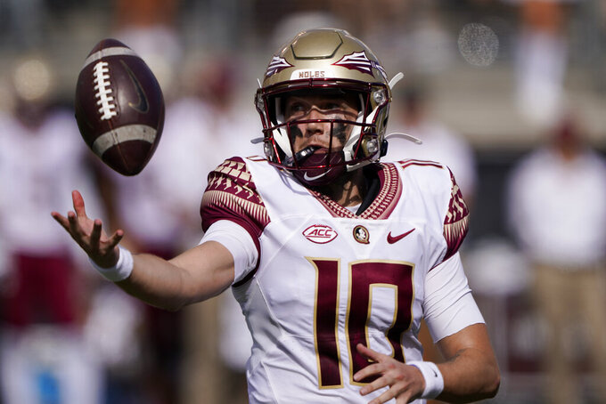 Florida State quarterback McKenzie Milton reaches for a wild snap during the first half of an NCAA college football game against Wake Forest, Saturday, Sept. 18, 2021, in Winston-Salem, N.C. (AP Photo/Chris Carlson)