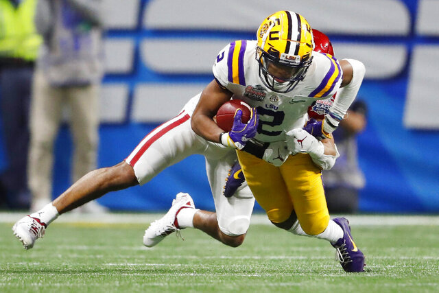 FILE - In this Dec. 28, 2019, file photo, LSU wide receiver Justin Jefferson (2) runs against Oklahoma cornerback Woodi Washington (5) during the second half of the Peach Bowl NCAA semifinal college football playoff game in Atlanta. This year's NFL draft features a superb group of wide receivers, including Jefferson, who are expected to make immediate impacts in the NFL.(AP Photo/John Bazemore, File)