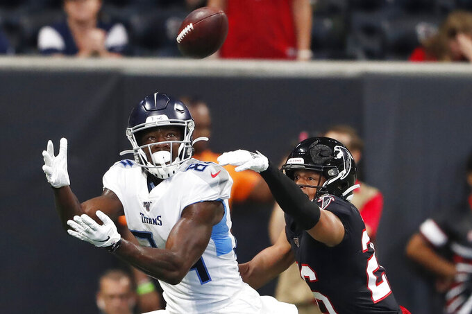 Tennessee Titans wide receiver Corey Davis (84) prepares to make a touchdown catch against Atlanta Falcons cornerback Isaiah Oliver (26) during the first half of an NFL football game, Sunday, Sept. 29, 2019, in Atlanta. (AP Photo/John Bazemore)