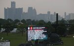 An inclement weather warning is displayed on Belle Isle before the first race of IndyCar Detroit Grand Prix's auto racing doubleheader, Saturday, June 1, 2019, in Detroit. Spectators were advised to exit the stands and seek shelter about 90 minutes before the scheduled start of the race. (AP Photo/Carlos Osorio)