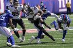 Atlanta Falcons running back Mike Davis (28) runs the ball against New York Giants linebacker Azeez Ojulari (51) during the first half of an NFL football game, Sunday, Sept. 26, 2021, in East Rutherford, N.J. (AP Photo/Bill Kostroun)