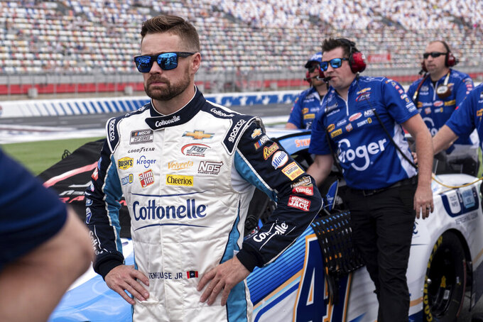 Ricky Stenhouse Jr. stands by his car before qualifying in second position for the NASCAR Cup Series auto race at Charlotte Motor Speedway on Saturday, May 29, 2021 in Charlotte, N.C. (AP Photo/Ben Gray)