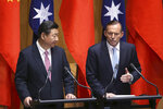 """FILE - In this Nov. 17, 2014, file photo, China's President Xi Jinping, left, and Australian Prime Minister Tony Abbott speak at a press conference following the signing of several memorandums of understanding to strengthen trade in Canberra, Australia. An India-Australia free trade agreement would signal the """"democratic world's tilt away from China,"""" trade envoy and former Australian Prime Minister Tony Abbott has written on Monday, Aug. 9, 2021. (AP Photo/Rick Rycroft, File)"""