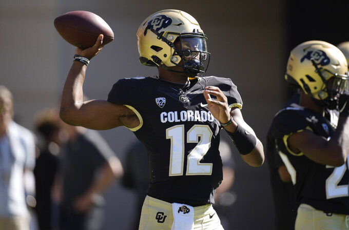 Colorado quarterback Brendon Lewis warms up before an NCAA college football game against Minnesota, Saturday, Sept. 18, 2021, in Boulder, Colo. (AP Photo/David Zalubowski)