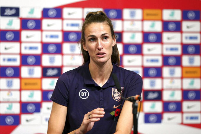 England's Jill Scott speaks during the press conference at Wembley Stadium, London, Friday Nov. 8, 2019. Returning to play at Wembley Stadium for a third time is a chance for Jill Scott to reflect. Scott using another visit by Germany on Saturday to bask in the advances in women's soccer in England. (Steven Paston/PA via AP)