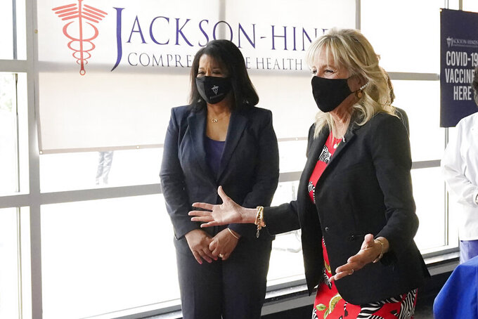 First lady Jill Biden, right, and Jackson-Hinds Comprehensive Health Center CEO Jasmin Chapman speak to recently vaccinated patients during a visit to a COVID-19 vaccination site at Jackson State University in Jackson, Miss., Tuesday, June 22, 2021, as part of Biden administration's nationwide tour to reach Americans who haven't been vaccinated and to promote vaccine education. (AP Photo/Rogelio V. Solis)