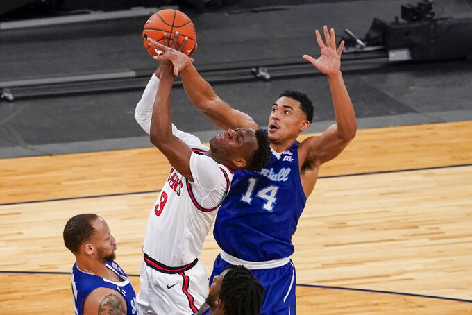 Seton Hall guard Jared Rhoden (14) stops St. John's guard Rasheem Dunn (3) from scoring during the second half of an NCAA college basketball game in the quarterfinals of the Big East conference tournament, Thursday, March 11, 2021, in New York. (AP Photo/Mary Altaffer)