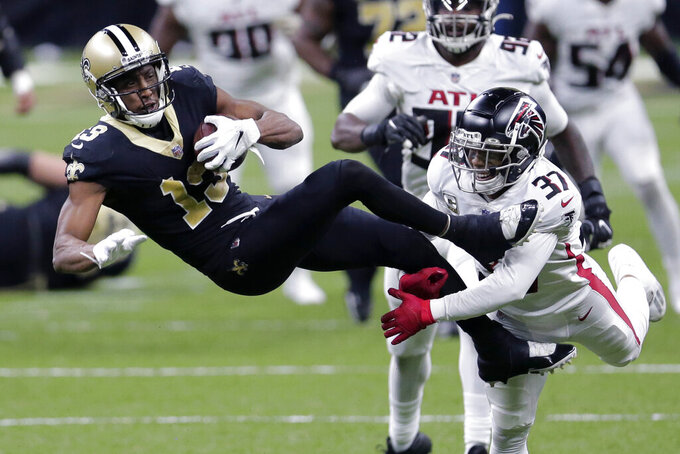 New Orleans Saints wide receiver Michael Thomas (13) pulls in a pass reception against Atlanta Falcons free safety Ricardo Allen (37) in the second half of an NFL football game in New Orleans, Sunday, Nov. 22, 2020. (AP Photo/Brett Duke)