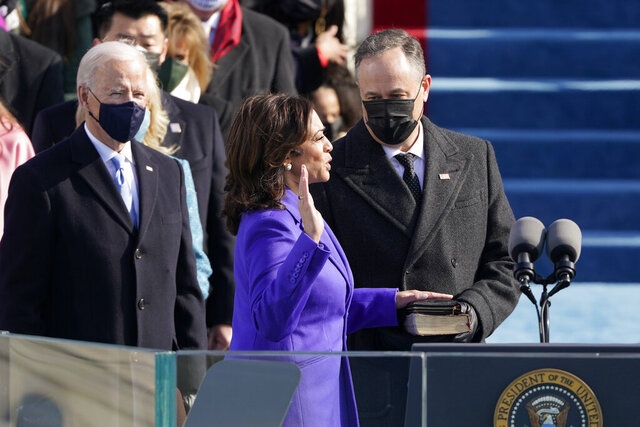 Kamala Harris is sworn in as vice president by Supreme Court Justice Sonia Sotomayor as her husband Doug Emhoff holds the Bible during the 59th Presidential Inauguration at the U.S. Capitol in Washington, Wednesday, Jan. 20, 2021. (AP Photo/Patrick Semansky, Pool)