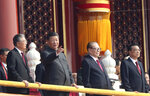 Chinese President Xi Jinping, center left, with former presidents Jiang Zemin, center right, and Hu Jintao, left, and  Premier Li Keqiang, right, attend the celebration to commemorate the 70th anniversary of the founding of Communist China in Beijing, Tuesday, Oct. 1, 2019. (AP Photo/Ng Han Guan)