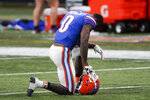 Florida defensive back Trey Dean III (0) kneels after the Southeastern Conference championship NCAA college football game against Alabama, Sunday, Dec. 20, 2020, in Atlanta. Alabama won 52-46. (AP Photo/John Bazemore)