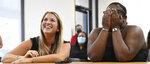 ADVANCE FOR PUBLICATION ON SUNDAY, MAY 16, AND THEREAFTER - MonyayFaithPaskalides, right, reacts as she becomes officially adopted by LeahPaskalides, left, during a Zoom adoption hearing, April 27, 2021, in Bradenton, Fla. (Thomas Bender/Sarasota Herald-Tribune via AP)
