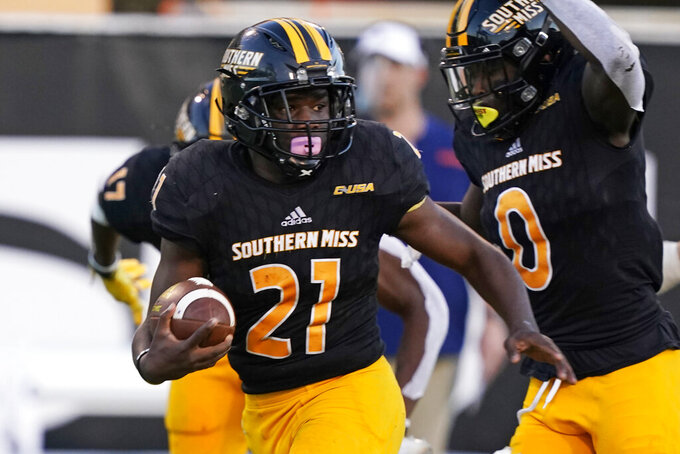 Southern Mississippi running back Frank Gore Jr. (21) looks for blockers as he scores on a 51-yard touchdown pass reception during the on a second half of an NCAA college football game against UTSA, Saturday, Nov. 21, 2020, in Hattiesburg, Miss. UTSA won 23-20. (AP Photo/Rogelio V. Solis)