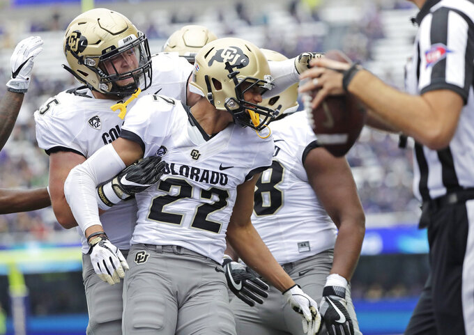 Colorado wide receiver Daniel Arias (22) celebrates with offensive lineman Brett Tonz, left, after Arias caught a pass for a touchdown against Washington during the first half of an NCAA college football game, Saturday, Oct. 20, 2018, in Seattle. (AP Photo/Ted S. Warren)