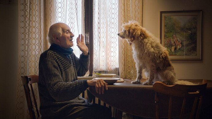 This image released by Sony Pictures Classics shows Aurelio Conterno and his dog Birba in a scene from