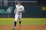New York Yankees' Giancarlo Stanton rounds the bases after hitting a home run against the Oakland Athletics during the fourth inning of a baseball game in Oakland, Calif., Friday, Aug. 27, 2021. (AP Photo/Jeff Chiu)