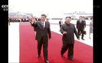In this image taken from a video footage run by China's CCTV, Chinese President Xi Jinping, left, and North Korean leader Kim Jong Un, right, wave as President Xi arrived at an airport in Pyongyang, North Korea, Thursday, June 20, 2019. The leaders of China and North Korea met in the North's capital on Thursday, their fifth meeting in 15 months, with stalled nuclear negotiations with Washington expected to be on the agenda. (CCTV via AP)