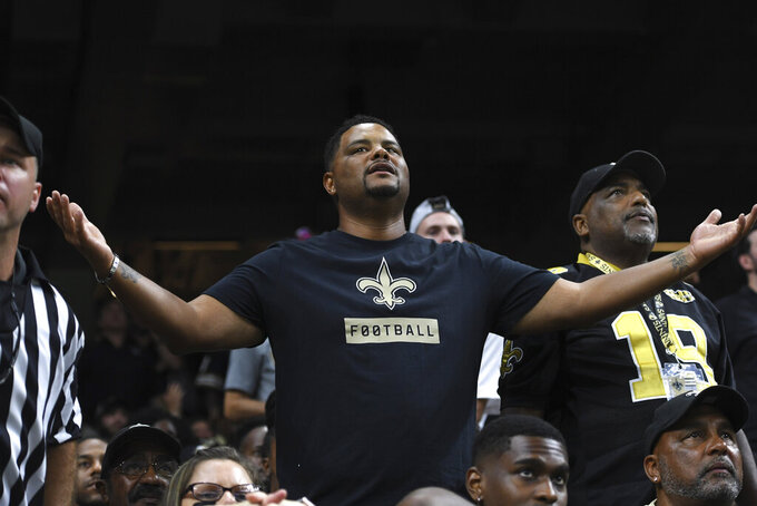 New Orleans Saints fans react in the first half of an NFL football game against the Houston Texans in New Orleans, Monday, Sept. 9, 2019. (AP Photo/Bill Feig)