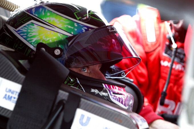 Justin Allgaier gets strapped into his race car prior to an NASCAR Xfinity Series auto race at Phoenix Raceway, Saturday, Nov. 7, 2020, in Avondale, Ariz. (AP Photo/Ralph Freso)