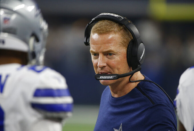 Dallas Cowboys head coach Jason Garrett speaks tp players on the sideline during the first half of the NFC wild-card NFL football game against the Seattle Seahawks, in Arlington, Texas, Saturday, Jan. 5, 2019. (AP Photo/Ron Jenkins)