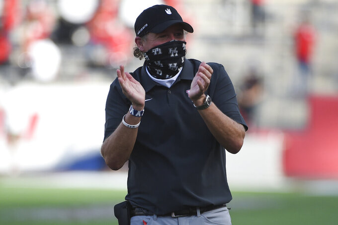 Houston head coach Dana Holgorsen celebrates the team's touchdown during the first half of an NCAA college football game against South Florida, Saturday, Nov. 14, 2020, in Houston. (AP Photo/Eric Christian Smith)