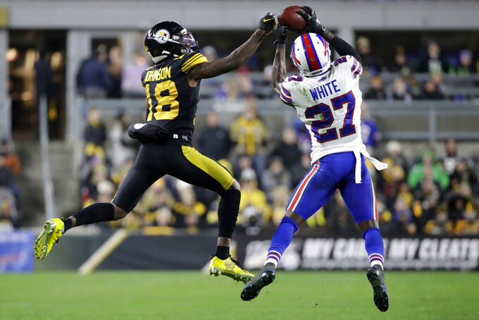 FILE - In this Dec. 15, 2019, file photo, Buffalo Bills cornerback Tre'Davious White (27) intercepts a pass intended for Pittsburgh Steelers' Diontae Johnson (18) during the second half of an NFL football game in Pittsburgh. A person with knowledge of the Bills' decision tells The Associated Press the team has picked up the fifth-year option on cornerback Tre'Davious White's contract. The person spoke on condition of anonymity because the team has not announced the decision.  (AP Photo/Don Wright, File)