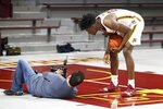 Minnesota's Daniel Oturu, right, checks out a photo of himself on photographer Carlos Gonzalez's camera during NCAA college basketball media day Friday, Oct. 18, 2019, in Minneapolis. (AP Photo/Jim Mone)