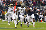 Chicago Bears wide receiver Cordarrelle Patterson (84) heads to the end zone for a touchdown on a kickoff return ahead of New Orleans Saints' Saquan Hampton (33) and Dwayne Washington (27) during the first half of an NFL football game in Chicago, Sunday, Oct. 20, 2019. (AP Photo/Mark Black)