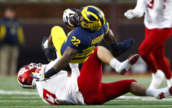 Indiana linebacker Micah McFadden (47) tackles Michigan running back Karan Higdon (22) in the first half of an NCAA college football game in Ann Arbor, Mich., Saturday, Nov. 17, 2018. (AP Photo/Paul Sancya)