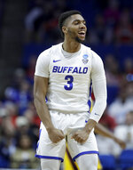 Buffalo's Jayvon Graves celebrates a basket during the first half of a first round men's college basketball game against Arizona State in the NCAA Tournament Friday, March 22, 2019, in Tulsa, Okla. (AP Photo/Charlie Riedel)