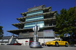 The Borg-Warner Trophy complete with a checkered flag mask, is displayed outside of the Pagoda before the Indianapolis 500 auto race at Indianapolis Motor Speedway, Sunday, Aug. 23, 2020, in Indianapolis.(AP Photo/Darron Cummings)