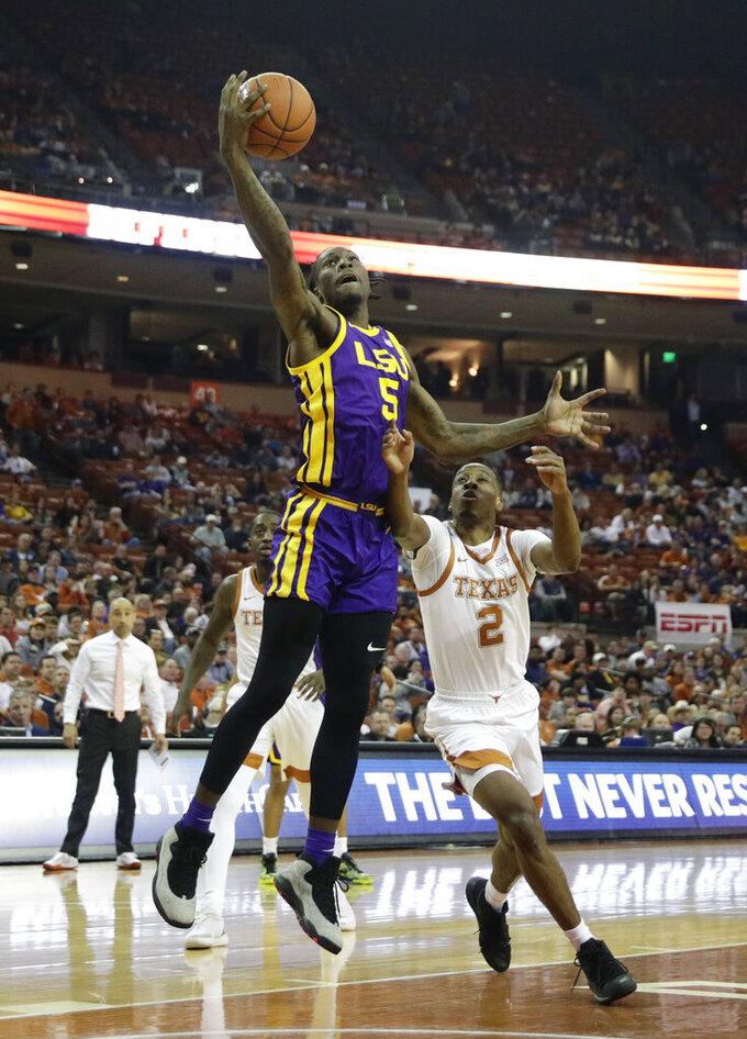 LSU forward Emmitt Williams (5) shoots over Texas guard Matt Coleman III (2) during the first half of an NCAA college basketball game, Saturday, Jan. 25, 2020, in Austin, Texas. (AP Photo/Eric Gay)