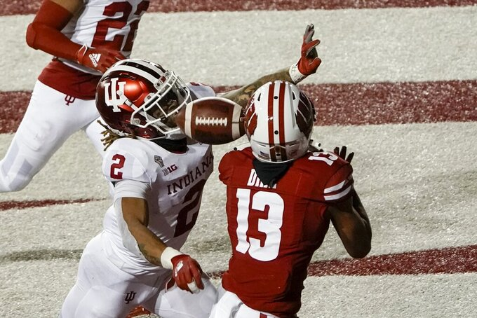Wisconsin's Chimere Dike can't catch a pass with Indiana defensive back Reese Taylor defending during the second half of an NCAA college football game Saturday, Dec. 5, 2020, in Madison, Wis.Indiana won 14-6. (AP Photo/Morry Gash)