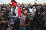 Anti-government protesters gather near Basra provincial council building during a demonstration in Basra, Iraq, Tuesday, Oct. 29, 2019. (AP Photo/Nabil al-Jurani)