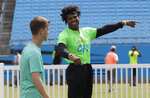 Carolina Panthers Cam Newton, right, jokes with a teammate during his charity kickball tournament in Charlotte, N.C., Friday, May 10, 2019. Both Panthers QBs will be action Friday. Cam Newton will be on the field at Bank of America Stadium throwing balls _ kickballs, that is _ as part of his annual Kicking it with Cam Kickball Tournament. Meanwhile rookie draft pick QB Will Grier will throwing footballs for the first time as Carolina opens rookie minicamp on the team's practice fields outside the stadium. (AP Photo/Chuck Burton)