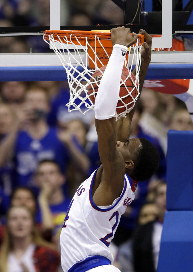 Kansas guard Lagerald Vick dunks during the second half of an NCAA college basketball game against Iowa State in Lawrence, Kan., Monday, Jan. 21, 2019. Kansas defeated Iowa State 80-76. (AP Photo/Orlin Wagner)