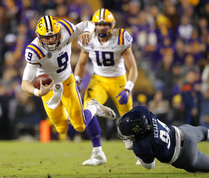 Rice defensive end Graysen Schantz (94) trips up LSU quarterback Joe Burrow (9) on a carry in the first half of an NCAA college football game in Baton Rouge, La., Saturday, Nov. 17, 2018. (AP Photo/Gerald Herbert)